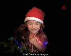 Photo accepted by Stockimo (vanya.bovajo) Tags: stockimo iphonegraphy iphone children christmas santa hat tree happy smiling cute toddler girl kid childhood caucasian winter home decoration decorating light