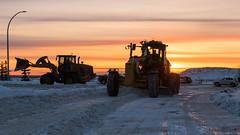 Grading, St Albert, Alberta (WherezJeff) Tags: alberta canada farmconstructionequipment industrials lacombelake park stalbert sunset weatherandseasons winter grader loader machinery plowing silhouette snow d850 s8a caterpiller