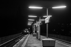 there comes the trainman / the city where the sun went missing (Özgür Gürgey) Tags: 2018 50mm bw d750 darkcity eppendorferbaum hamburg nikon evening lowlight rails repetition subway