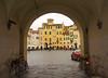 Lucca - Scorcio Piazza Anfiteatro (Darea62) Tags: lucca square town tuscany bikes anfiteatro toscana borgo ancient history buildings circus pavement architecture arch