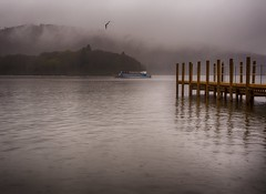 Ferry in the mist (razorlitexx) Tags: windermere lakewindermere lakedistrict rain mist fog ferry boat seagull jetty lake lakes british britishcountryside countryside water cold spring ambleside