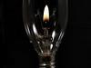 Flame (Millie Cruz *Catching up slowly!) Tags: macromondays flame lamp chandelier lightandshadow blackbackground doubleexposure macro bulb incandescent crystal clear