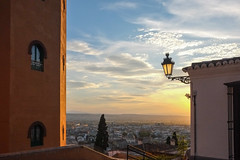 Sunset in Granada (Marian Pollock) Tags: spain granada sunset light buildings clouds city vista fromabove windows alhambra hotel tree dusk cityscape cloud