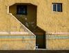 Weird Entrance (Chris Lakoduk) Tags: entrance shapes sizes windows stairs stucco walls colorful yellow stripes urban exploration odd town tamron 45mm nikon photography street