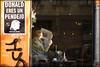 reader in a café (piktorio) Tags: berlin germany cafe window kreuzberg candles sunshine street man newspaper reader reading donald pendejo protest poster piktorio typo spanish