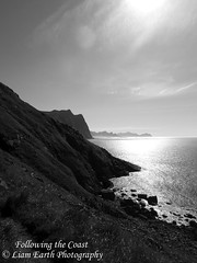 Following the Coast (liamearth) Tags: earth shore sky mountain sceneic wilderness beautiful sea view outdoor water western landscape wild lofoten norway arctic circle traveling real life camping serene mountainside still clear texture contrast ocean cliff bay beach vestvågøya unstad rock bw blackandwhite monochrome eggum
