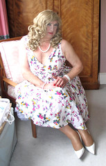 Coraflowdrsit-001 (fionaxxcd) Tags: crossdresser tranny trannie tv stiletto longblonde rednail necklace petticoat cleavage tights flowerydress