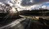 Round the bend (Phil-Gregory) Tags: nikon d7200 naturalphotograph naturephotography road light bend sun peakdistrict eyam snow winter wideangle ultrawide countryside colour cold ngc