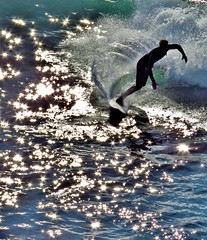 star surfing (moonjazz) Tags: surfing california silver photography pacificocean santacruz dazzling light speed action stars glitter bright water wave smooth swift athlete surfboard current ride winner shine twinkle reflections