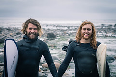 Surfing in January (Joel Apple) Tags: seaweed sombriobeach surfboard ocean vancouverisland northamerica britishcolumbia wetsuits pacificnorthwest people holdinghands surfers lowtide pacific rocks