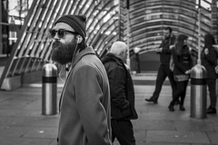 Pacing (Leanne Boulton) Tags: people urban street candid portrait streetphotography candidstreetphotography candidportrait streetportrait streetlife man male face beard standing beanie sunglasses style stylish fashion mood atmosphere winter tone texture detail depthoffield bokeh waiting naturallight outdoor light shade shadow city scene human life living humanity society culture canon canon5d 5dmkiii 50mm primelens ef50mmf14usm black white blackwhite bw mono blackandwhite monochrome glasgow scotland uk