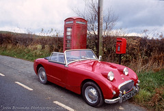 Red And The Best Of British.         Kodachrome 64 (RED FROG SPRITE) Tags: phonebox 724eyc eric austin healey sprite film nikon 801 wales telephonebox postbox red uk classic oldtimer