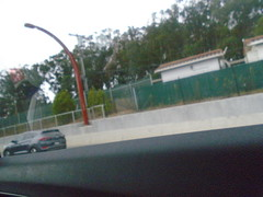 DSC01312 (classroomcamera) Tags: home car carride ride drive driving passenger highway road traffic fast go passing lane green trees concrete way adventure field trip