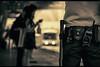 Bangkok Club Scene (Carl's Captures) Tags: phayathaistation ratchathewidistrict bangkokthailand bts bangkokmasstransitsystem skytrain transportation urban elevatedrail rapidtransit thai siam asian southeastasia cityscape police safety officer belt radio weapon club handle cop lawandorder security billyclub leatherpouches selectivefocus dof bokeh platform shelter approachingtrain waitingpassengers uniform รถไฟฟ้า sukhumvitline candid story streetshooting streetphotography monochrome splittones nikond5100 tamron18270 photoshopbyfehlfarben thanksbinexo