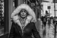 Sub Zero (Leanne Boulton) Tags: portrait urban street candid portraiture streetphotography candidstreetphotography candidportrait streetportrait eyecontact candideyecontact streetlife woman female lady face expression eyes catchlights look emotion mood feeling winter weather cold icy fur furry hood coat style fashion tone texture detail depthoffield bokeh naturallight outdoor light shade city scene human life living humanity society culture people canon canon5d 5dmkiii 70mm ef2470mmf28liiusm black white blackwhite bw mono blackandwhite monochrome glasgow scotland uk