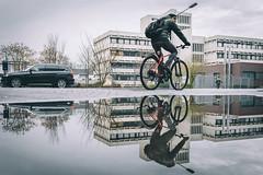 Waterbike (Zesk MF) Tags: bike mirroring zesk 18mm sigmaart street candid people leute strase color pfütze puddle spiegelung reflection water