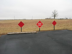3 Signs, 2 Words, One Log (EX22218 - ON/OFF) Tags: red stop log wood white weeds branches pavement field leaves curb concrete asphalt sealcoat louisville kentucky waste land realestate cancer cell accidents traffic planning area bad signs words parkinglot