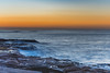 Sunrise Seascape (Merrillie) Tags: daybreak sunrise puttybeach nature australia rockplatform waterscape centralcoast morning sea newsouthwales rocks earlymorning nsw outdoors bouddinationalpark ocean landscape water rocky coastal clouds sky seascape cloudy coast dawn waves