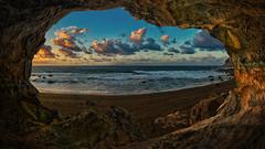 Living in a cave (Jörg Bergmann) Tags: beach cave clouds ocean photomontage rocks sea seascape sky sunset framing m43 mft gf7 gm1 lumix panasonic gomera lagomera lapalma islascanarias playainglés microfourthirds micro43