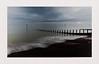 Light on the Horizon (hall1705) Tags: lightonthehorizon sea seascape breakwater beacheslandscapes beach felpham westsussex clouds stormy weather horizon sunset