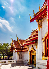"""Wat Benchamabophit (The Marble Temple) Bangkok Thailand-7 (Yasu Torigoe) Tags: watbenchamabophitdusitvanaramwhichmeans""""themonasteryo bangkok krungthepmahanakhon thailand th wat benchamabophit dusitvanaram which means """"the monastery fifth king near dusit palace"""" is buddhist temple district it known marble one bangkoks bestknown temples major tourist attraction typifies ornate style high gables with steppedout roofs elaborate finials construction began 1899 built italian the cloister around assembly hall houses 52 images buddha"""