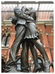 Lovers (The Stig 2009) Tags: lovers girl woman female man couple statue kings cross st pancras station train meeting place area platform apple iphone 6s kissing pair legs high heels pencil up skirt candid street hot voyeur
