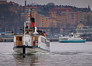 The archipelago boat Angantyr in Stockholm, in the background the commuter boat Emelie