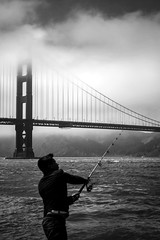 fishing at the golden gate (GeoMatthis) Tags: san francisco california goldengate bridge fishing motion black white gray usa seaside america west pacific kontrast contrast