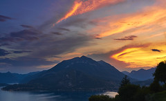 demon eye (Marc R. A.) Tags: sky sunset mountain clouds color beautiful italy lago como lake water landscape nature hill tree