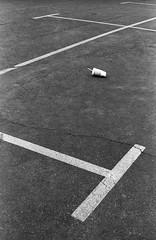 discarded (jollyville) Tags: blackandwhite film 35mm praktica prakticamtl5b pentax supertakumar50mmf14 supertakumar takumar kentmere kentmere100 d76 kodakd76 parkinglot m42