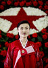 North Korean woman posing in front of a red star made of flowers at the international Kimilsungia and Kimjongilia festival, Pyongan Province, Pyongyang, North Korea (Eric Lafforgue) Tags: adult asia asianethnicity celebration communism decoration dictatorship dprk dprk1343 exhibition face festival flowers indoors kimilsungia kimjongilia northkorea northkorean oneperson onewomanonly people plant portrait propaganda pyongyang red traveldestinations vertical woman women pyonganprovince 北朝鮮 북한 朝鮮民主主義人民共和国 조선 coreadelnorte coréedunord coréiadonorte coreiadonorte 조선민주주의인민공화국 เกาหลีเหนือ קוריאההצפונית koreapółnocna koreautara kuzeykore nordkorea північнакорея севернакореја севернакорея severníkorea βόρειακορέα