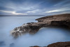 Stone over Blue (Fernando Piçarra) Tags: green coastline idyllic horizon over water seascape riverbank bay rocky waters edge sea headland beach stone bridge cascais cabo raso clouds blue brown seashore seaside rocks long exposure portugal ocean atlantic