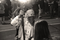 Flambeau Man (BKHagar *Kim*) Tags: bkhagar mardigras neworleans nola parade flambeau flambeaux crowd people light flame flames fire tradition monochrome man kerchief night outdoor street napoleon uptown