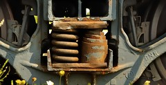 Two kinds of (rusty) springs (edk7) Tags: nikond50 edk7 2007 canada ontario perthcounty stratford stationsiding train railway railroad rwy rr excanadiannationalrailway excn excnr wedge bucker snowplow rollingstock mechanical rust spring coil helical wheel casting brakeshoe suspension rustyandcrusty helix
