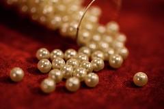 Pearls In A Bottle--HMM! (amarilloladi) Tags: bokehlicious red crushedvelvet 7dwf bottle pearls macromondays inabottle