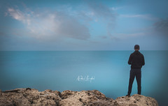 Edge of the World (Nabeel Iqbal) Tags: edge world man standing long exposure sea ocean watar clouds motion calm silent camera canon 6d qatar doha wakra wakrah al middle east photography landscape seascape view