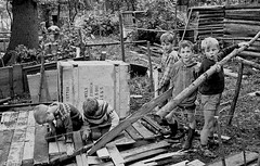 Supervised play (theirhistory) Tags: children child boys kids play building wood construction scrap junk trousers jacket jumper wellies shoes boots