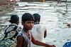 A Young Candle Seller in Varanasi (Sessiongraff) Tags: inde varanasi uttarpradesh in candle aarti boy seller flower ganga gange holy fleur vendeur bougie ritual rituel rite