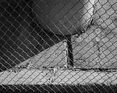 IMGP1875 (agianelo) Tags: freeway overpass concrete chain link fence monochrome bw blackandwhite