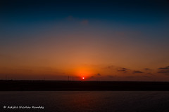Sunset in the Suez Canal (Askjell) Tags: egypt maritime ships suez suezcanal vessel canal transit