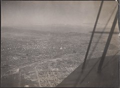 Page 77, no. 5: Aerial view of Los Angeles (Derek Doran Wood) Tags: aerialphoto aerialview city losangeles cityhall lariver losangelesriver downtown 1920s biplane aerial cityscape landscape hollywoodhills