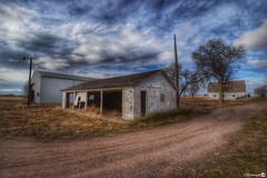 Dilapidated Garage (CTfotomagik) Tags: garage country weldcounty ruraldecay northerncolorado nikon wideangle abandoned weathered sky clouds dirt road art artist
