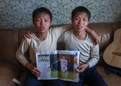 Portrait of North Korean twins holding a french football magazine, North Hamgyong Province, Jung Pyong Ri, North Korea (Eric Lafforgue) Tags: 1314years asia asianethnicity boy boys boysonly child childhood children childrenonly colourimage communism dictatorship dprk football horizontal lookingatcamera nkorea9955 northhamgyongprovince northkorea northkorean people photo portrait twinbrothers twins twopeople youth jungpyongri 北朝鮮 북한 朝鮮民主主義人民共和国 조선 coreadelnorte coréedunord coréiadonorte coreiadonorte 조선민주주의인민공화국 เกาหลีเหนือ קוריאההצפונית koreapółnocna koreautara kuzeykore nordkorea північнакорея севернакореја севернакорея severníkorea βόρειακορέα