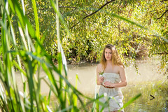 Blonde on the water (barak.shacked) Tags: portrait face beutifull blueeyes holdingflower nearwater look female barearms נחלירקון youngwoman tree river woman blonde alone green water standinginthewater whitedress beuty