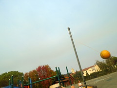DSC01845 (classroomcamera) Tags: school campus playground blacktop concrete tether tetherball yellow ball swing hit hitting swinging pole metal leaves red green blue sky clear cloudless day daytime outside outdoors fall autumn