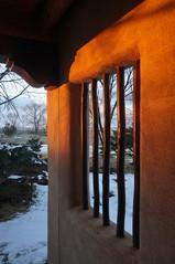 security (rovingmagpie) Tags: newmexico taos sagebrushinn window sundown security wood snow inn bars bday2018