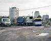 Wrocław, Poland. (wojszyca) Tags: mamiya rz67 6x7 120 mediumformat 110mm gossen lunaprosbc epson v800 kodak ektachrome e100g city urban dirt parking landscape chaos truck bus towerblock