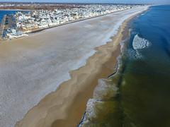 A snow-covered Manasquan Beach and the Atlantic Ocean, captured by a DJI Phantom 4 drone. (apardavila) Tags: atlanticocean djiphantom4 fb jerseyshore manasquan manasquanbeach aerial beach beachfronthomes drone morning sky snow