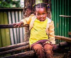 Hello World (liesbet_sanders) Tags: africa eastafrica ethiopia menagesha girl child kid cute beautiful black tails beads shy smile wooden bench port portraitmood