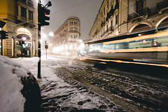 Urban transportation in Turin italy under the snow (Mirko Macari) Tags: black blur bokeh city dark downtown drive empty evening exposure illuminated life light long motion night nightlife nobody old outdoors people perspective point rain red road scene speed stone street town traffic train tram tramway transport transportation travel turin urban wet streetphotography